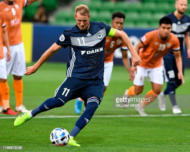 Melbourne Victory's Ola Toivonen scores from the spot against Chiangrai United during their AFC Champions League football match in Melbourne on...