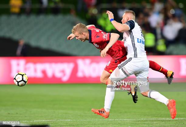 Melbourne's Besart Berisha shoves Adelaide's Jordan Elsey during the round three ALeague match between Adelaide United and Melbourne Victory at...