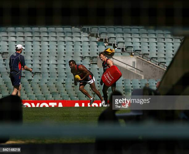 Melbourne's Byron Pickett and James McDonald during training at a closed session at Subiaco seen through the tunnel from outside the ground 14...