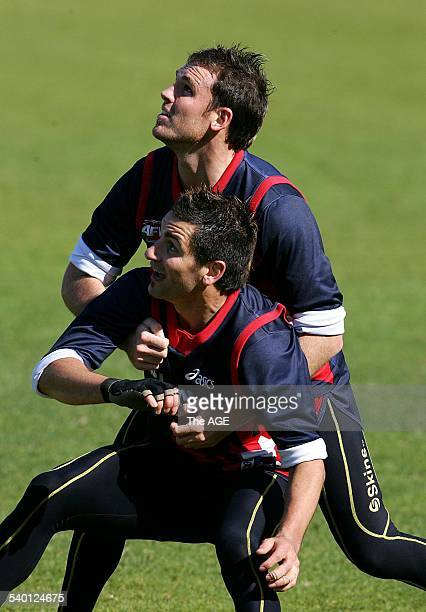 Melbourne's Cameron Bruce atop and Adem Yze battle at training on 2nd September 2006 THE AGE SPORT Picture by SEBASTIAN COSTANZO