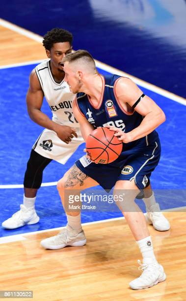 Melbourne's Casper Ware guards Adelaide's Mitch Creek during the round two NBL match between the Adelaide 36ers and Melbourne United at Titanium...