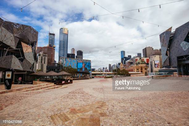 Melbourne's iconic Federation Square is oddly quiet and empty during the Coronavirus pandemic and associated lockdown.- PHOTOGRAPH BY Chris Putnam /...
