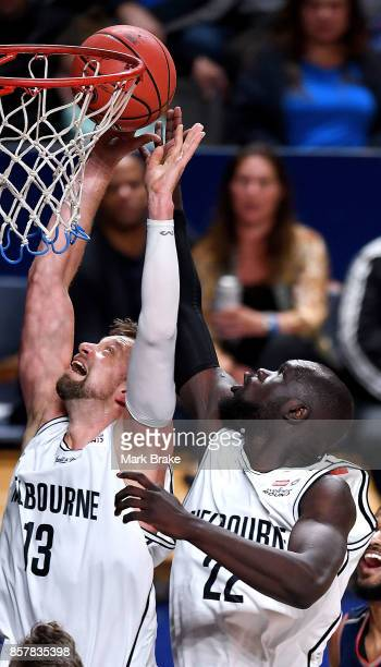Melbourne's Majok Majok gives team mate Dave Anderson a touch to score during the round one NBL match between the Adelaide 36ers and Melbourne...