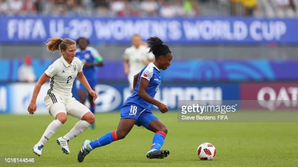 Melchie Dumonay of Haiti breaks away from Dina Orschmann of Germany is tackled by of Haiti during the FIFA U20 Women's World Cup France 2018 group D...