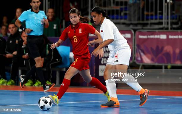 Mele Kafa of Tonga challenges Antonia Martinez of Spain in the Women's Group C match between Tonga and Spain during the Buenos Aires Youth Olympics...