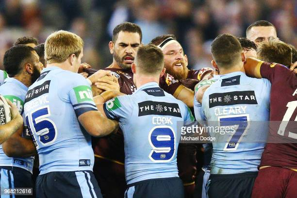 A melee breaks out after Greg Inglis of the Maroons tackled Tom Trbojevic of the Blues during game one of the State Of Origin series between the...