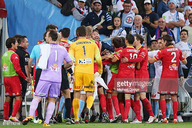 A melee breaks out at half time during the round 27 ALeague match between the Melbourne City FC and Adelaide United at AAMI Park on April 8 2016 in...