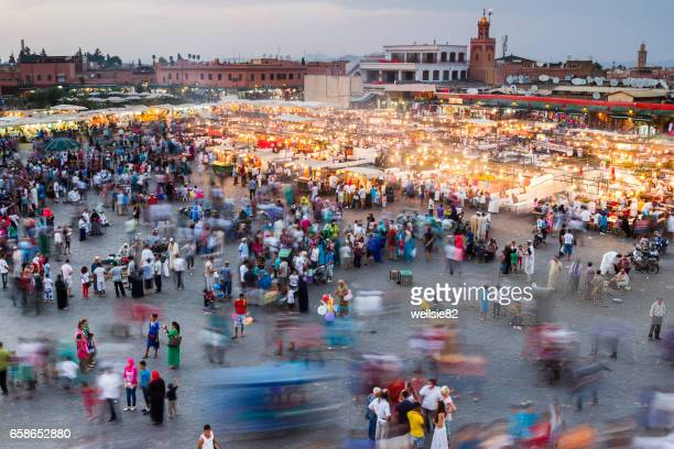 melee in marrakech - djemma el fna square stock photos and pictures