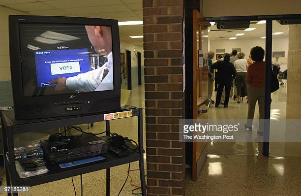 A video shows how to use the voting machines on election day at Hollin Meadows Elementary school in Alexandria VA