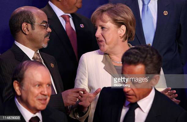 Meles Zenawi Ethiopia's Prime Minister top left speaks with Angela Merkel Germany's chancellor second right prior to the family photograph at the G8...