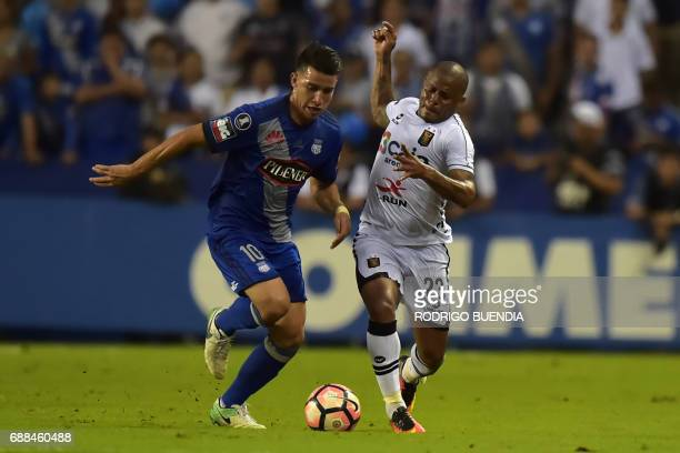 Melgar's Wilmer Aguirre vies for the ball with Emelec's Fernando Gaibor during their 2017 Copa Libertadores football match at George Capwell stadium...