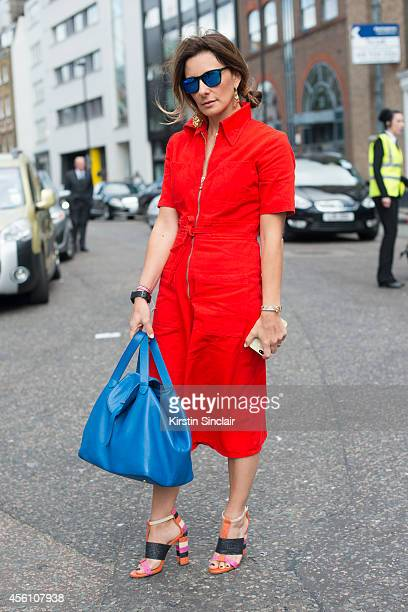 Meli Melo Bag designer Melissa De Bono wears Zara shoes, Meli Melo bag, vintage jumpsuit and Centrostyle sunglasses on day 4 of London Fashion Week...