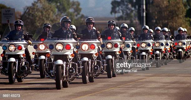 MELightsmotorcade2KH12/14/95Motor officers form a motorcade and drive around the Anaheim Stadium parking lot with their lights on Law enforcement...