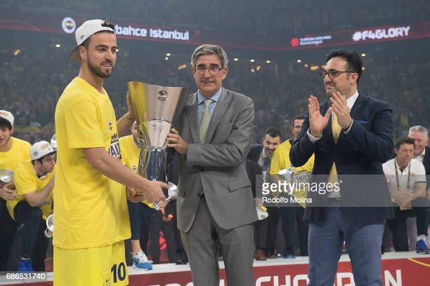 Melih Mahmutoglu #10 of Fenerbahce Istanbul receive from Jordi Bertomeu President and CEO of Euroelague Basketball during the 2017 Final Four...