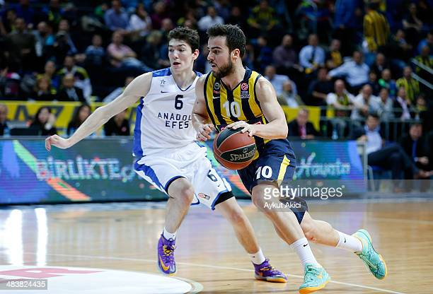 Melih Mahmutoglu #10 of Fenerbahce Ulker Istanbul competes with Cedi Osman #6 of Anadolu Efes Istanbul in action during the 20132014 Turkish Airlines...