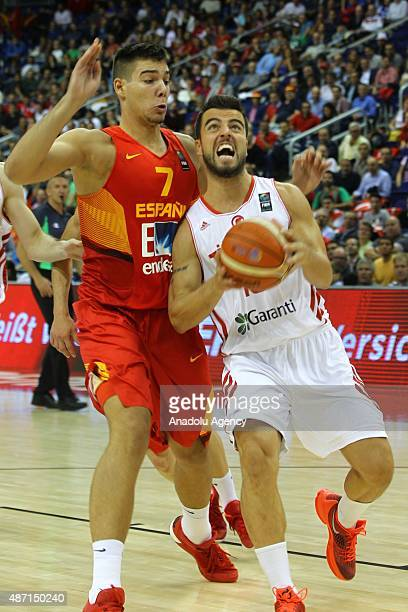 Melih Mahmutoglu of Turkey vies for the ball during the FIBA EuroBasket 2015 Group B basketball match between Turkey and Spain at Mercedes Benz Arena...