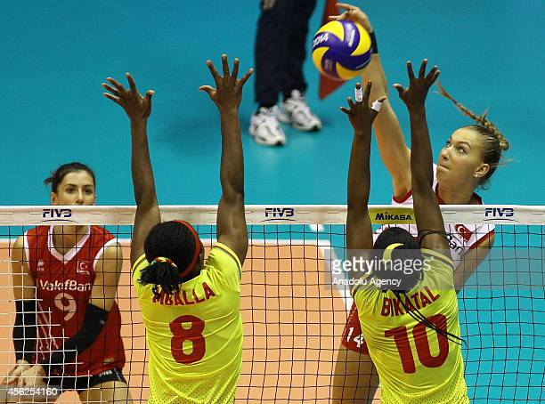Meliha Ismailoglu and Merve Dalbeler of Turkey in action against Mballa and Bikatal of Cameroon during the 2014 FIVB Volleyball Women's World...