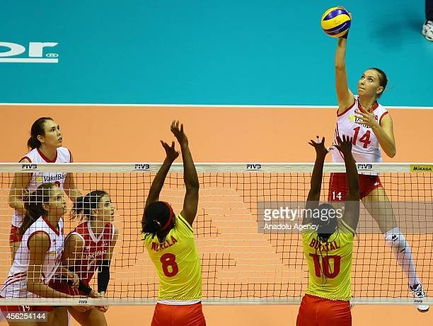 Meliha Ismailoglu of Turkey in action against Mballa and Bikatal of Cameroon during the 2014 FIVB Volleyball Women's World Championship Group B...