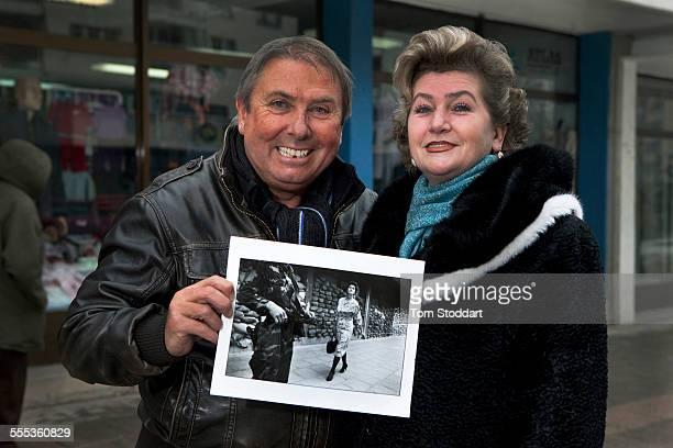 Meliha Varesanovic with Tom Stoddart pictured at the same place in the Dobrinja suburb of Sarajevo where photographer Tom Stoddart photographed her...