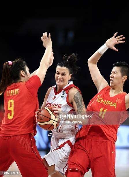 Melike Bakircioglu of Turkey in action against SiJing Huang and Meng Li of China during the friendly women's basketball match between Turkey and...