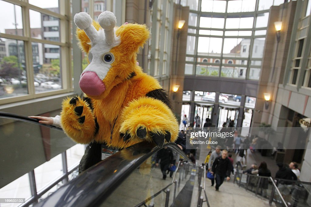 Melikka Budnick, dressed as a Girafarig, from Pokemon, takes the escalator inside the Prudential Center Mall during the Anime Boston Convention on May 25, 2013.