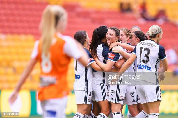 Melina Ayres of Melbourne celebrates scoring a goal with team mates during the round ten WLeague match between the Brisbane Roar and Melbourne...