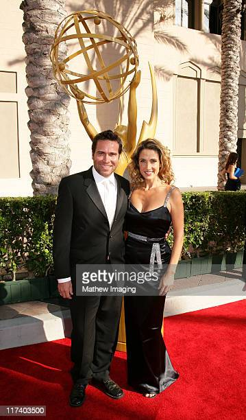 Melina Kanakaredes and guest during 58th Annual Creative Arts Emmy Awards Red Carpet at The Shrine Auditorium in Los Angeles California United States