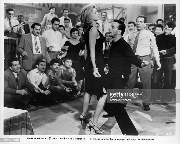 Melina Mercouri dances with a man in a scene from the film 'Never On Sunday', 1960.