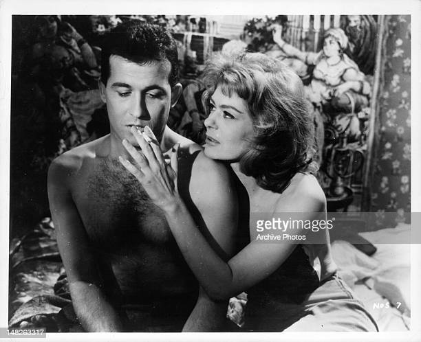 Melina Mercouri grabbing for Jules Dassin's cigarette in a scene from the film 'Never on Sunday', 1960.