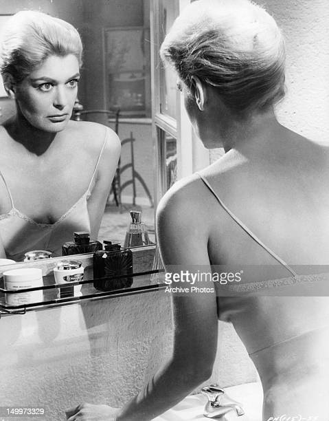 Melina Mercouri looking at herself in the mirror in a scene from the film 'Phaedra', 1962.