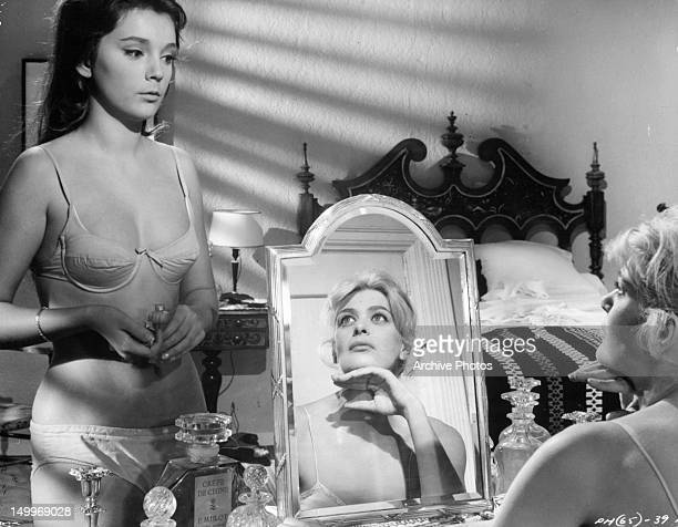 Melina Mercouri looking up at barely dressed woman in a scene from the film 'Phaedra', 1962.