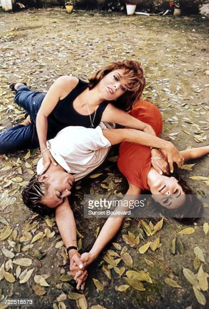 Melina Mercouri Peter Finch and Romy Schneider on the set of '1030 PM Summer' directed by Jules Dassin 1965 This image was used on a poster for the...