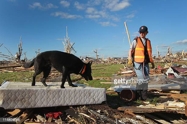 Melinda Clark from the Illinois/Wisconsin search and rescue team uses her dog to search for possible victims of the massive tornado that passed...