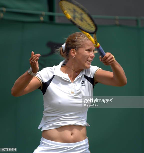 Melinda Czink of Hungary in action during the Women's Singles first round match against Ana Ivanovic of Serbia on day three of the Wimbledon Lawn...