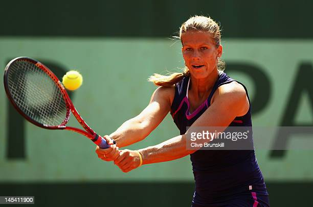Melinda Czink of Hungary plays a backhand in her women's singles first round match between Anne Keothavong of Great Britain and Melinda Czink of...