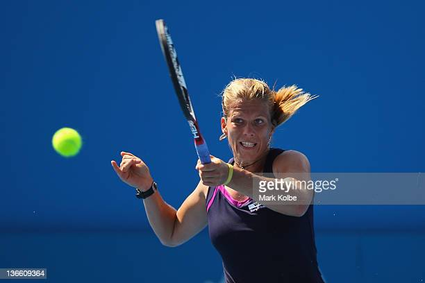 Melinda Czink of Hungary plays a forehand during her first round match against Chanelle Scheepers of South Africa during day two of the 2012 Sydney...