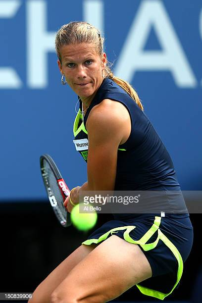 Melinda Czink of Hungary plays a forehand during her women's singles first round match against Maria Sharapova of Russia on Day One of the 2012 US...