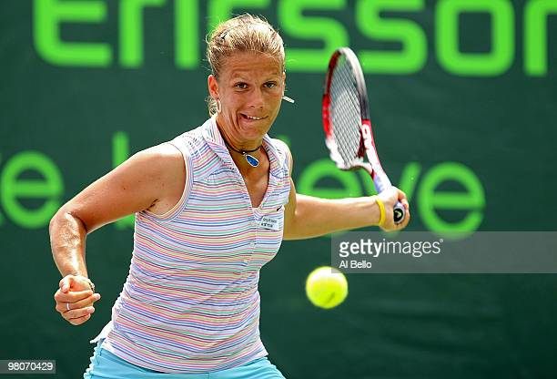 Melinda Czink of Hungary returns a shot against Maria Kirilenko of Russia during day four of the 2010 Sony Ericsson Open at Crandon Park Tennis...