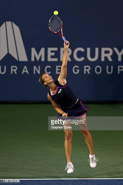 Melinda Czink of Hungary serves to Jelena Jankovic of Serbia during day six of the Mercury Insurance Open Presented By TriCity Medical at La Costa...
