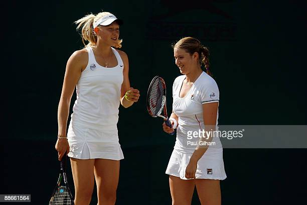 Melinda Czink of Hungary talks tactics with Natalie Grandin of South Africa during the women's doubles first round match against Anna-Lena Groenefeld...