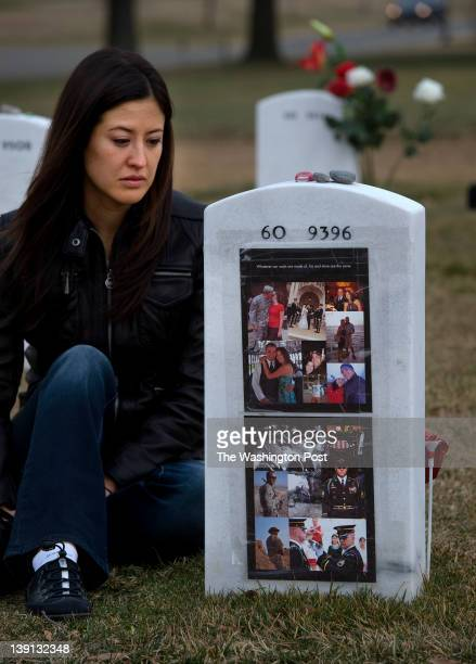 Melinda Dickmyer spends Valentines Day with her deceased husband US Army Staff Sargent Adam Dickmyer at Arlington National Cemetery on February 14...
