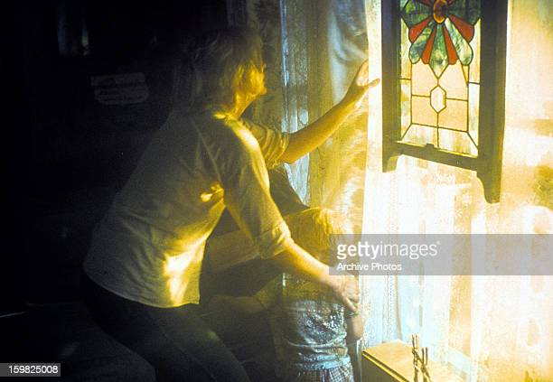 Melinda Dillon looking out a window in a scene from the film 'Close Encounters of the Third Kind' 1977