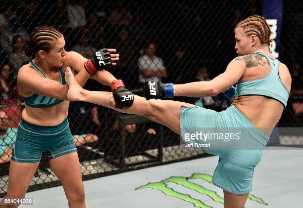 Melinda Fábián of Hungary kicks DeAnna Bennett in their women's flyweight bout during the TUF Finale event inside Park Theater on December 01 2017 in...