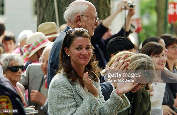 Melinda Gates and Bill Gates Sr., applaud as Microsoft co-founder and Chairman Bill Gates, gives the commencement speech at Harvard University June...