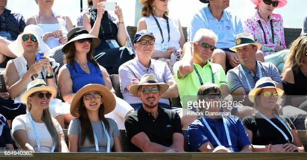 Melinda Gates Bill Gates and Larry Ellison follow the semifinals match between Roger Federer of Switzerland and Jack Sock of the United States during...