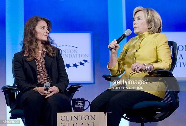 Melinda Gates CoChair and Trustee Bill Melinda Gates Foundation and former US Secretary of State Hillary Clinton speak during the 2014 Clinton Global...
