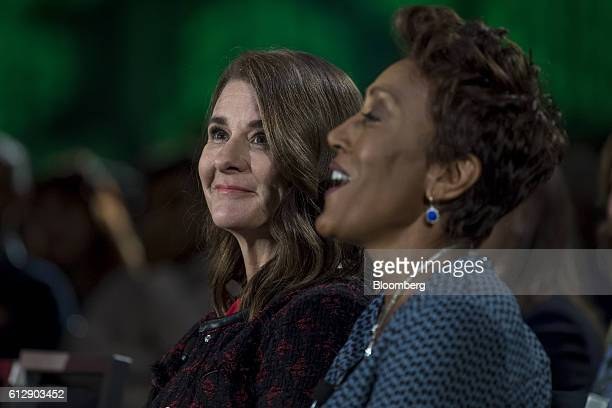 Melinda Gates cochair of the Bill and Melinda Gates Foundation left and Robin Roberts anchor of ABC News Inc's Good Morning America react during a...