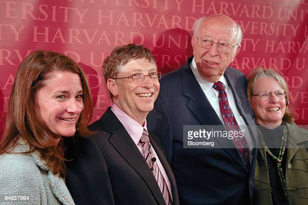 Melinda Gates left to right Bill Gates Microsoft Corp chairman William Gates Jr and Mimi Gates father and mother of Bill Gates gather for a photo...