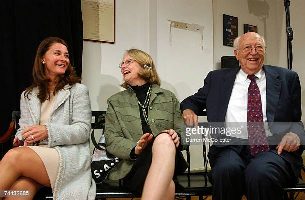 Melinda Gates, Mimi and Bill Gates Sr., wait for Microsoft co-founder and Chairman Bill Gates to speak at a press conference following his...