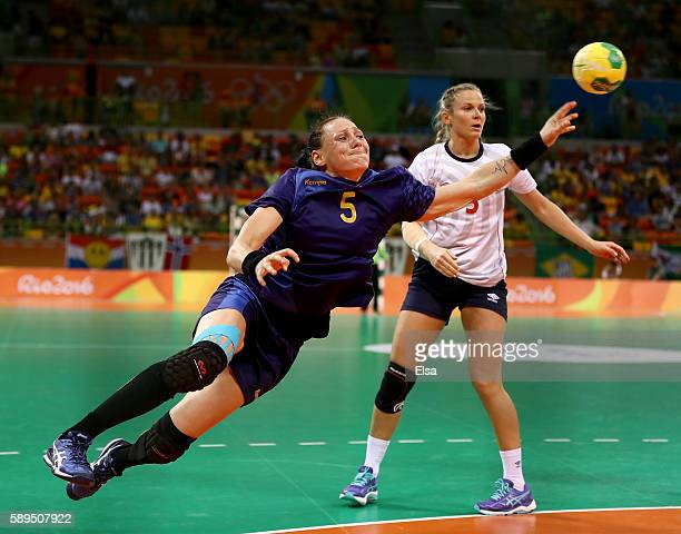 Melinda Geiger of Romania takes a shot as Ida Alstad of Norway defends on Day 9 of the Rio 2016 Olympic Games at the Future Arena on August 14, 2016...